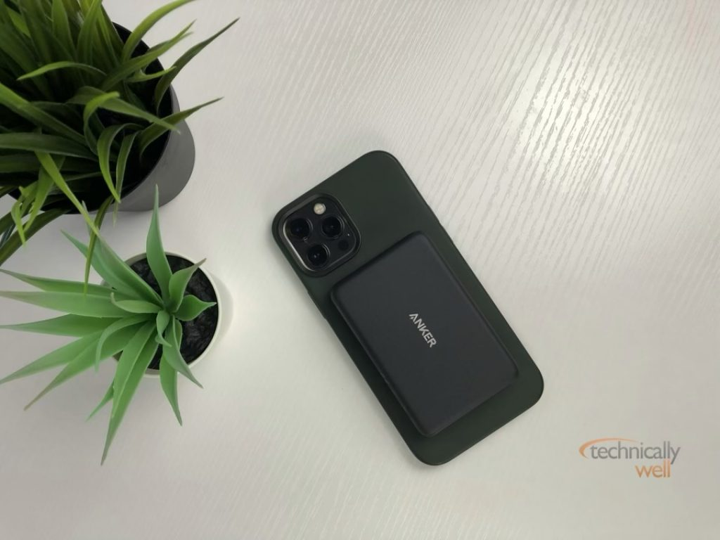 The Anker PowerCore Magnetic 5K Wireless power bank attached to an iPhone 12 Pro Max with silicone case
